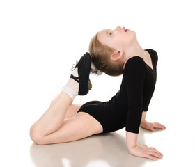 Gymnast cute little girl doing exercises isolated