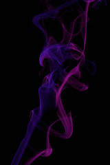 Pink and blue colored smoke pattern on black