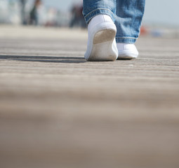 Portrait of a female walking in comfortable white shoes