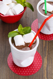 Hot chocolate with marshmallows decorated with mint leaves