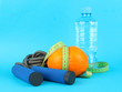Orange with measuring tape,skipping rope and bottle of water,