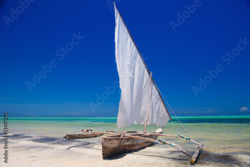 wooden boat in crisp blue water