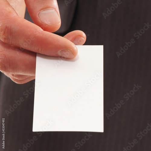 Close-up image of a businesscard held in a hand