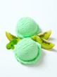 Scoops of light green ice cream