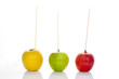 Three apples with straws