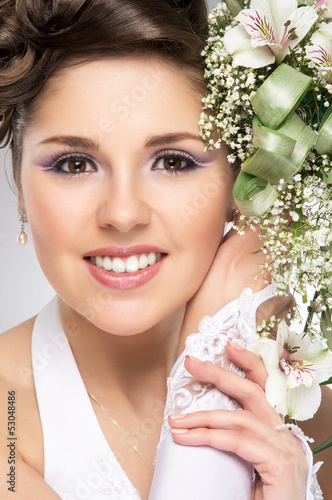Portrait of a young bride witha a flower bouquet