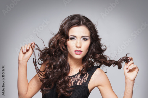 Beauty portrait of a young and attractive brunette woman