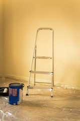 Home improvement concept with ladder and yellow wall