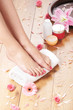 Spa background with a beautiful legs, flowers and petals
