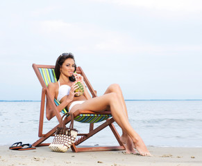 Beautiful and healthy young woman near the sea