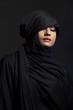 Indian beautiful Muslim girl portrait on dark background.