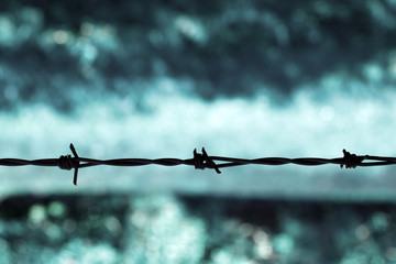 Barbed wire against a blue background