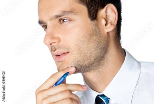 Portrait of thinking businessman, on white
