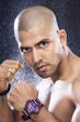Portrait of boxer on black background