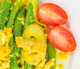 Stir fried green beans with scrambled eggs, and cherry tomato.