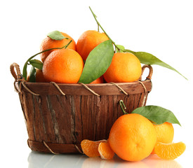 Ripe sweet tangerine with leaves in basket, isolated on white