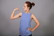 Funny girl in  vest shows off her biceps