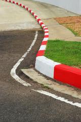 Sidewalk curb.