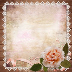 Rose with ribbon on vintage background