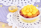 Beautiful lemon cupcakes on dining table close-up
