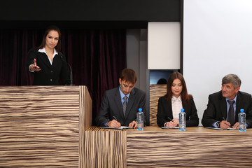 Business woman is making a speech at conference room
