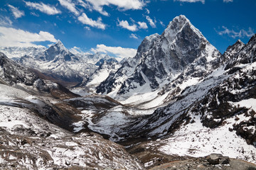 Mountains Ama Dablam, Cholatse, Tabuche Peak at the blue sky wit