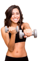 Beautiful fitness woman lifting weights