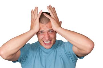Mann mit Händen am Kopf