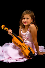 Girl holding violin in pink dress