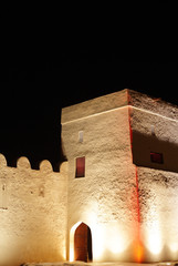 Beautiful illuminated entrance of Riffa fort, Bahrain