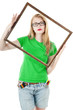 Girl  holds empty frame  from picture.