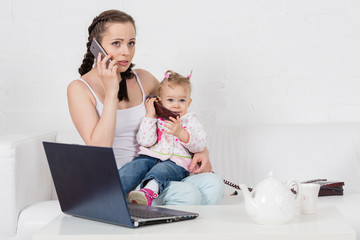 Mother and baby with phone.