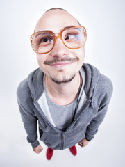 funny man with big glasses cross looking and smiling