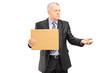 Broken businessman holding a piece of cardboard and begging