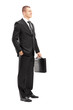 Full length portrait of a young businessman with briefcase posin