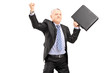 Happy mature businessman with briefcase gesturing happiness