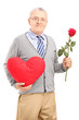 Mature gentleman holding a red heart and flower