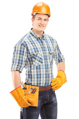 Confident and smiling manual worker with helmet looking at camer