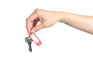 Side view of a woman hand giving a house keys