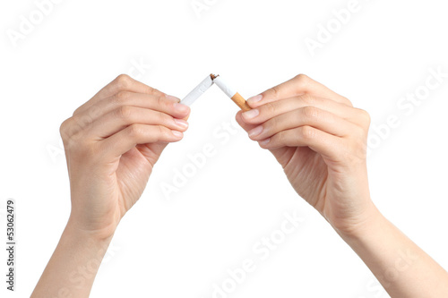 Woman hands breaking a cigarette