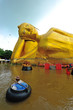flood waters overtake a big buddha statue  in Thailand