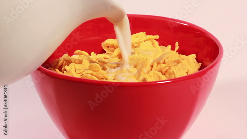 Healthy breakfast with milk and corn flakes.