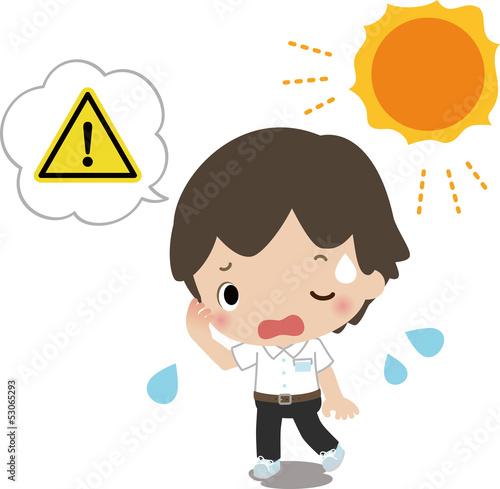 熱中症の危険を感じる男子中学生