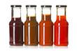 Leinwanddruck Bild - various barbecue sauces in glass bottles