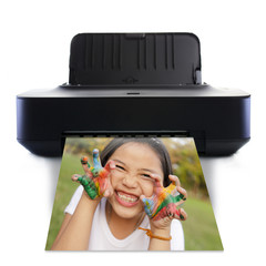 Printer and picture and Little girl with hands in colorful paint