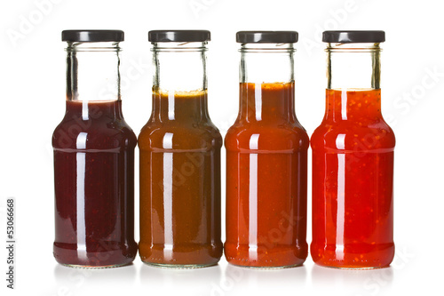 various barbecue sauces in glass bottles - 53066668