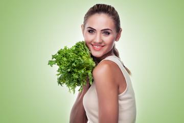 woman with bundle herbs (salad). Concept vegetarian dieting