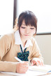 a young asian school girl studying