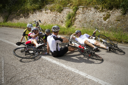 Group of men lying on the Ground After a Bike Accident