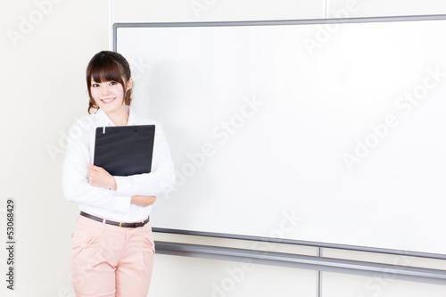 beautiful asian teacher in the classroom